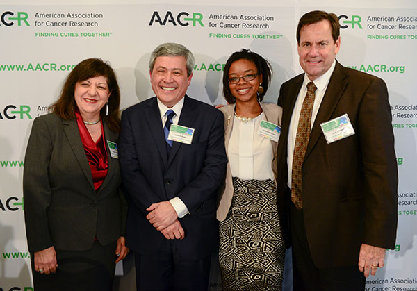AACR CEO Margaret Foti, PhD, MD (hc), with AACR President Carlos L. Arteaga, MD, and cancer survivors Jameisha Brown and Jack Whelan during the release of the AACR Cancer Progress Report 2014 held at the National Press Club in Washington, DC, on Sept. 17, 2014. (Photo by Alan Lessig)