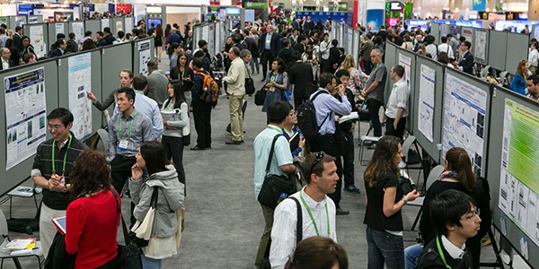 AACR Annual Meeting 2014 attendees during a poster session.