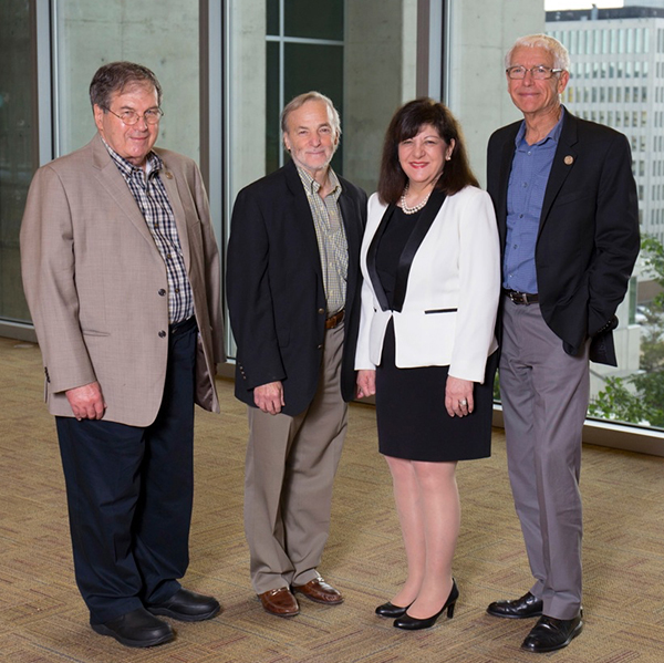 Margaret Foti, PhD, MD (hc), with (left to right) AACR Fellows George F. Vande Woude, PhD, Stephen Baylin, MD, and Peter A. Jones, PhD, DSc, of the Van Andel Institute. Baylin and Jones lead the VARI-SU2C Epigenetics Dream Team. Photo courtesy of the Van Andel Institute.