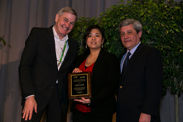 Cindy Lin, PhD, (center) received the AACR-Millennium Fellowship in Multiple Myeloma Research at the 2015 AACR Annual Meeting Grants Dinner. Presenting Lin with the award is Manfred Lehnert, MD, (left) vice president and head of Innovation at Takeda Pharmaceuticals and Carlos L. Arteaga, MD, past-president of the AACR. Photo by © AACR/Todd Buchanan 2015