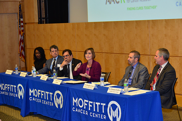 Rep. Kathy Castor speaks on a panel alongside Rep. Gus Bilirakis at Moffitt Cancer Center on March 7, 2016, about the importance of federal funding for cancer research.