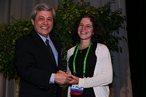 Yvonne Saenger, MD, receives her grant award from AACR Past President Carlos Arteaga, MD, at the AACR Annual Meeting 2015. Photo by © AACR/Todd Buchanan 2015