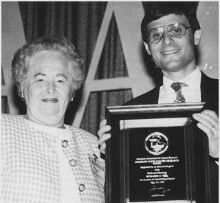 Benjamin Neel Receving Elion Award from Gertrude Elion