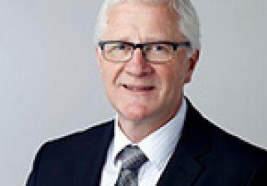 John E. Dick, PhD, FAACR